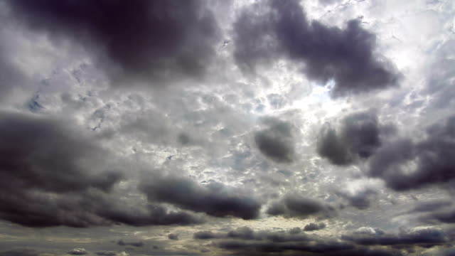 Sunlights run on black clouds in sky after rain video
