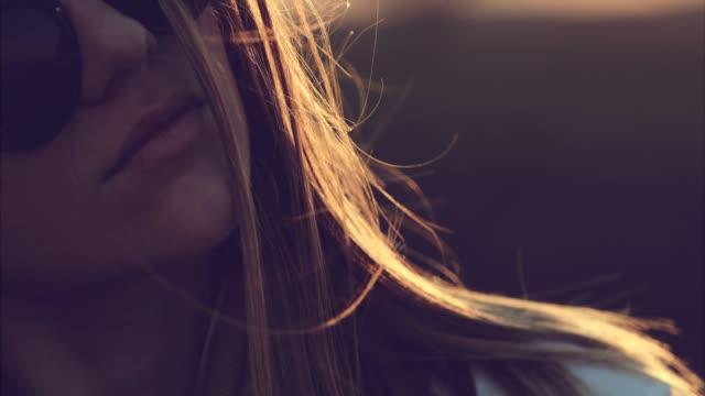 sunny but dark portrait - spettinato video stock e b–roll