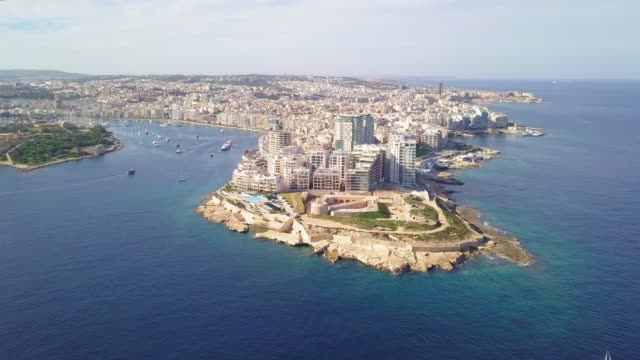 Sunny Day Above Sliema, Malta Sliema is a resort town on the east coast of the Mediterranean island of Malta. knight person stock videos & royalty-free footage
