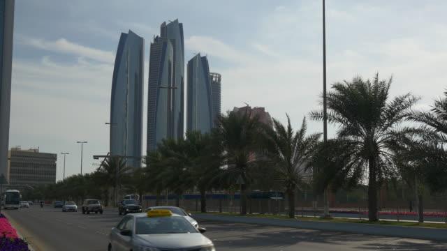 sunny day abu dhabi famous etihad towers bay traffic street panorama 4k united arab emirates - uae national day стоковые видео и кадры b-roll