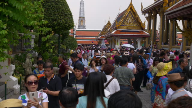 sunny day bangkok wat phra kaew temple tourist crowded entrance panorama 4k thailand video