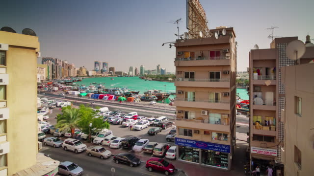 sunny day deira roof top dubai creek panorama 4k time lapse united arab emirates video