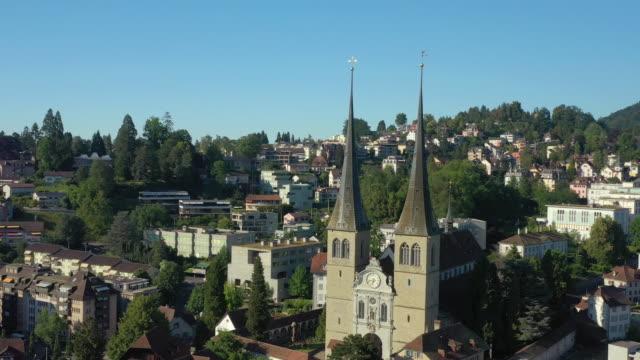sunny day flight over luzern city church aerial panorama 4k switzerland - vídeo