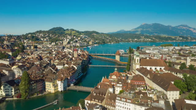 sunny day flight over luzern city river to lake aerial panorama 4k timelapse switzerland - vídeo