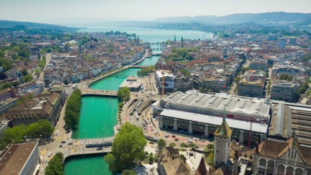 sunny day flight over zurich city center river train station district aerial panorama 4k timelapse switzerland - vídeo
