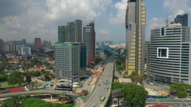 sunny day kuala lumpur city downtown traffic road aerial panorama 4k malaysia - kuala lumpur video stock e b–roll