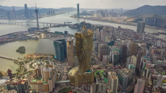 sunny day macau city famous hotel downtown bay aerial panorama 4k timelapse china - zhuhai video stock e b–roll