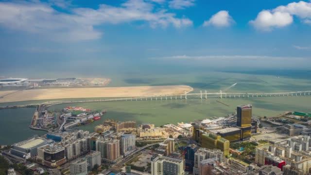 sunny day macau city famous traffic bridge bay bay aerial panorama 4k timelapse china - zhuhai video stock e b–roll