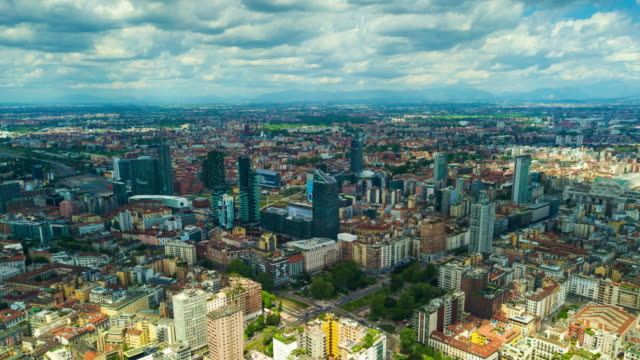 sunny day milan city modern downtown aerial panorama 4k time lapse italy sunny day milan city modern downtown aerial panorama 4k timelapse italy lombardy stock videos & royalty-free footage