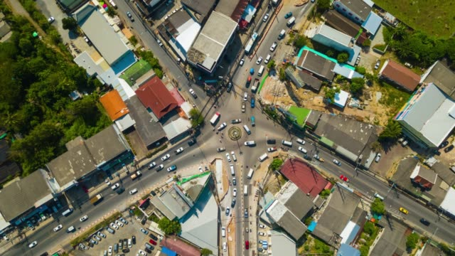 sunny day phuket island chalong town traffic street circle aerial down view 4k time lapse thailand - phuket video stock e b–roll