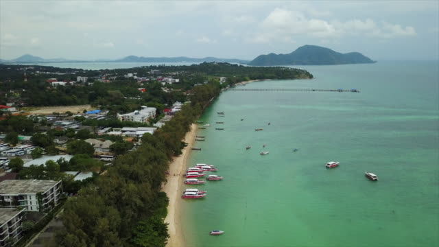 sunny day phuket island famous boat traffic rawai beach aerial panorama 4k thailand sunny day phuket island famous boat traffic rawai beach aerial panorama 4k thailand indian ocean stock videos & royalty-free footage