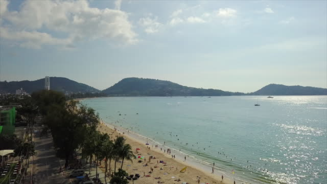 sunny day phuket island famous patong beach coastline aerial panorama 4k thailand - пхукет стоковые видео и кадры b-roll