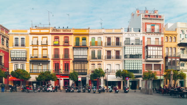 sunny day seville colored buildings and scooter parking 4k time lapse spain video
