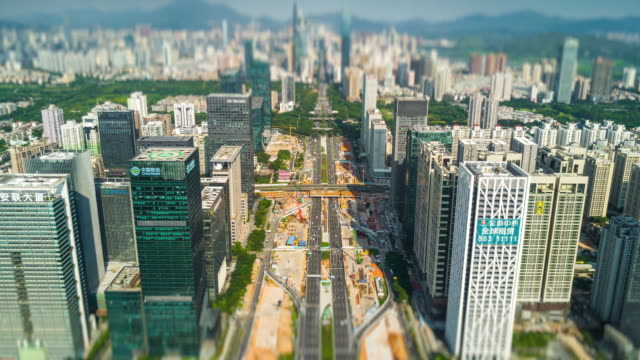 sunny day shenzhen cityscape downtown traffic street construction aerial panorama 4k tilt shift timelapse china - шэньчжэнь стоковые видео и кадры b-roll