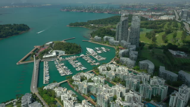 sunny day singapore city apartment complex yacht dock marina port bay aerial panorama 4k