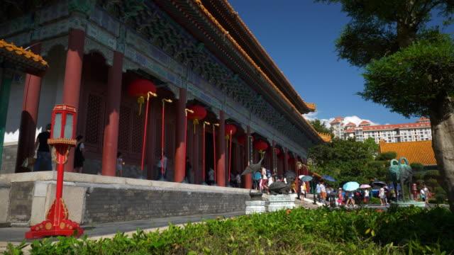 sunny day zhuhai city park temple front slow motion panorama 4k china - zhuhai video stock e b–roll