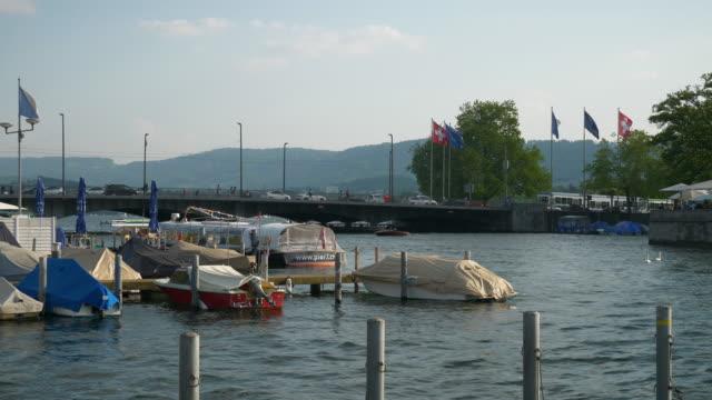 sunny day zurich riverside bay dock boat parking slow motion panorama 4k switzerland