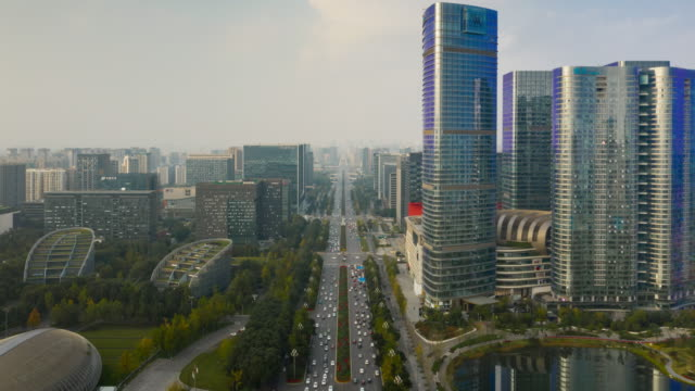 sunny evening chengdu city financial district traffic street road aerial timelapse panorama 4k china video
