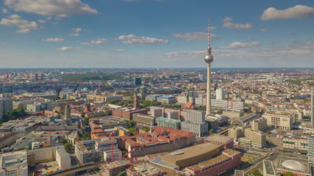 sunny evening flight over berlin cityscape famous tv tower aerial panorama 4k timelapse germany