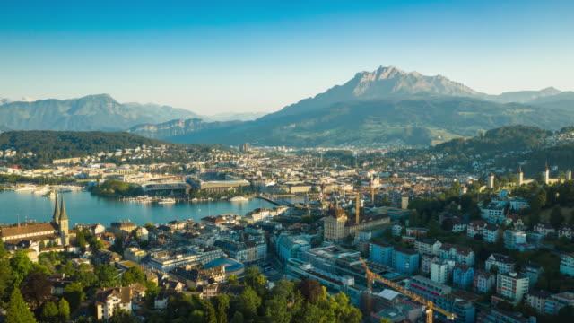 sunny evening flight over luzern city lakeside bay mountains skyline aerial panorama 4k timelapse switzerland - vídeo