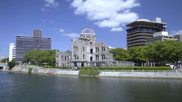 sunny sky atomic bomb dome and high tide motoyasugawa - hiroshima filmów i materiałów b-roll