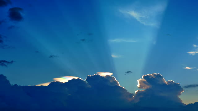 Sunrays from behind the cloud video