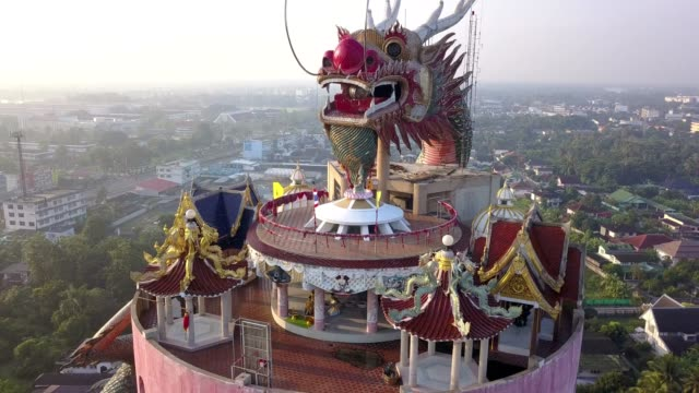 sunrise 4k aerial view of wat samphran, dragon temple in the sam phran district in nakhon pathom province near bangkok, thailand. - wat video stock e b–roll