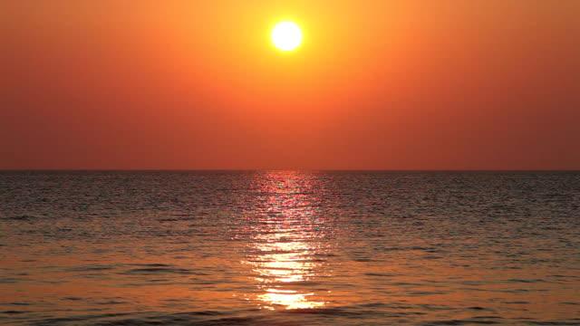 HD: Sunrise above the sea Sunrise above open sea. aegean islands stock videos & royalty-free footage