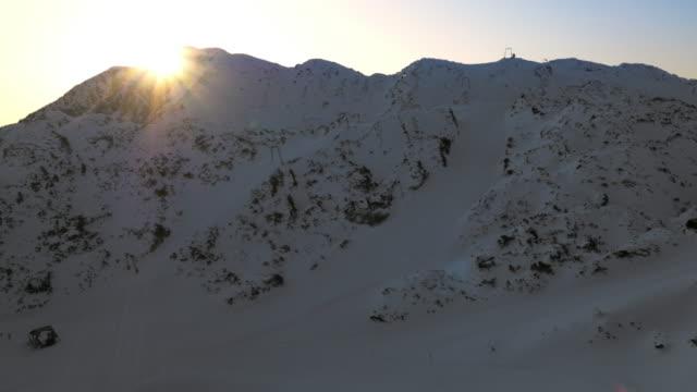 AERIAL Sunrise above the ski slope video