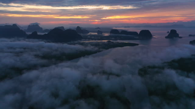 Sunrise aerial view of a forest on a misty morning at Phang-nga Bay
