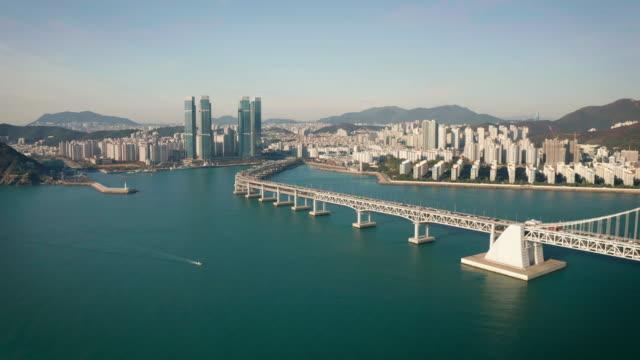 vídeos de stock e filmes b-roll de sunrise aerial view of gwangan bridge - coreia do sul