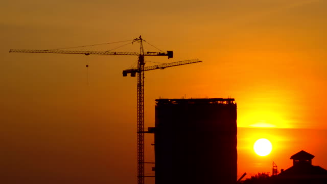 sunrise at construction site time lapse sunrise at construction site time lapse foundation make up stock videos & royalty-free footage
