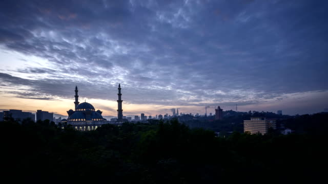Sunrise at Federal Mosque, Kuala Lumpur with silhouette Kuala Lumpur city skyline video