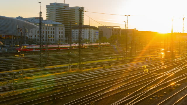 Sunrise at Hauptbahnhof Train Station, Munich,Germany Zoom Out 4K Time-Lapse :Main Train Station,Munich , Germany railroad track stock videos & royalty-free footage