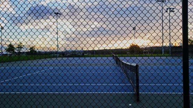 sunrise at tennis court 4k - space background стоковые видео и кадры b-roll