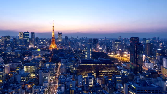 Sunrise at Tokyo city skyline 4k time lapse of night to day sunrise over the horizon of Tokyo city skyline dawn stock videos & royalty-free footage