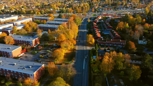 Sunrise. Flying over suburban Stockholm, apartment buildings, villas, road Flying over suburban Stockholm, apartment buildings, villas, road stockholm stock videos & royalty-free footage