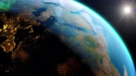 istock Sunrise from night skyline with aurora light. Earth from space. The globe spinning on satellite view space travel. Realistic 3d rendering animation. elements of this image furnished by NASA. 1309918019