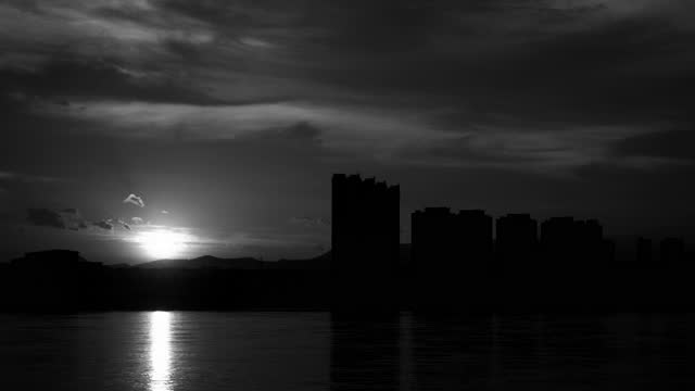 Sunrise glow cityscape Black & white 4K Scene of sunrise glow cityscape on the riverside,4K Black & white Time Lapse Video black and white architecture stock videos & royalty-free footage