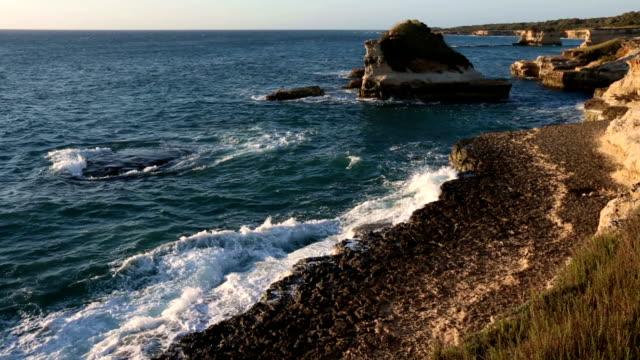 sunrise grotta dello mbruficu, salento sea coast, italy - lecce video stock e b–roll