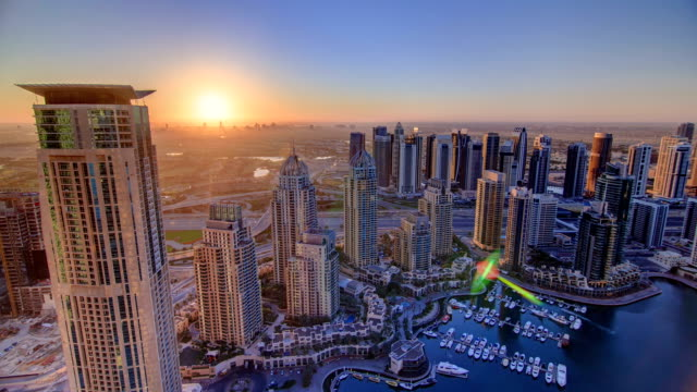 Sunrise in Dubai Marina with towers and harbor timelapse 4K video