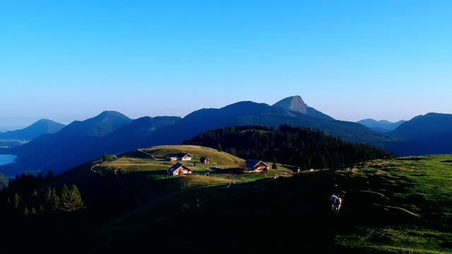 sunrise in the austrian alps in summer - capanna video stock e b–roll