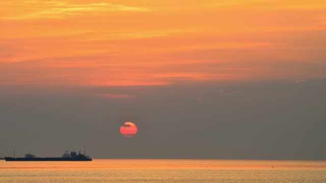Sunrise in the background of transportation ship.