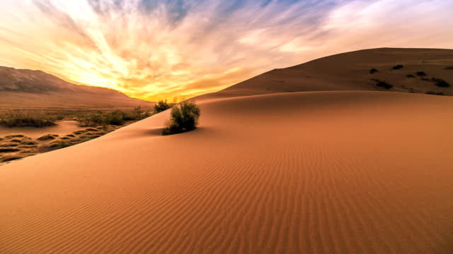 Sunrise in the Singing Sand Dunes in Altyn Emel video
