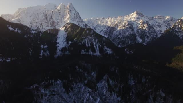 Sunrise Lighting on Aerial Floating to Big Snow Covered Peaks of Mount Index, Washington video