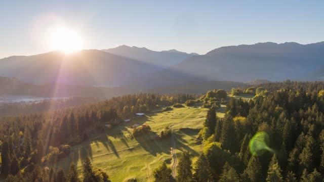 vídeos de stock e filmes b-roll de sunrise mountains above nature field switzerland aerial 4k - suíça