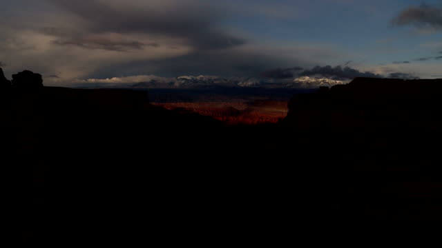 sunrise moving clouds over canyon timelapse video