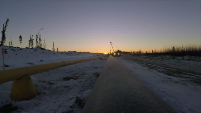 soluppgång på byggarbetsplats - pipeline bildbanksvideor och videomaterial från bakom kulisserna