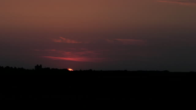 Sunrise on red sky - countryside scene background time-lapse video