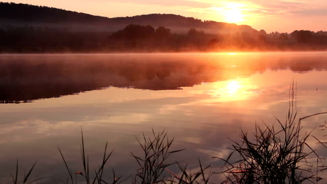 Sunrise on the lake, sunrise over river, morning landscape video